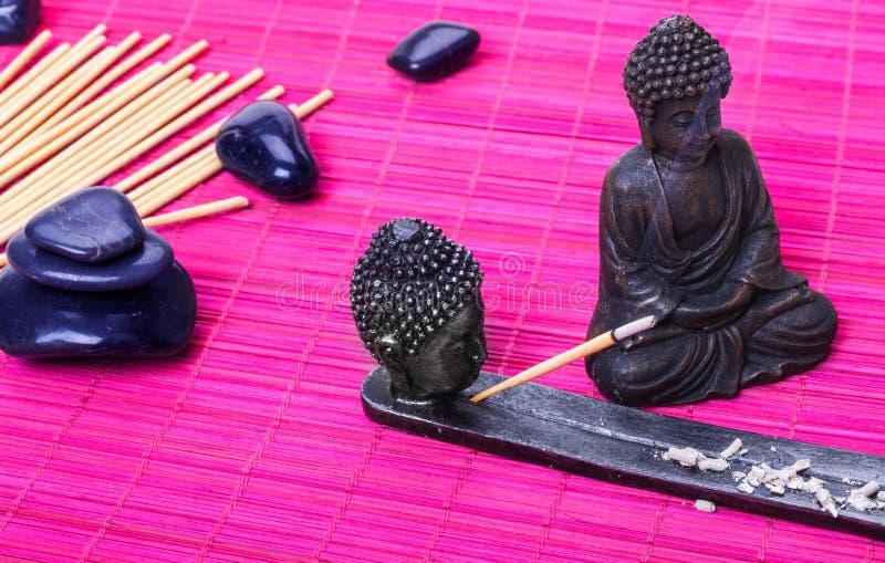 Buddha, bastoni di incenso immagine stock