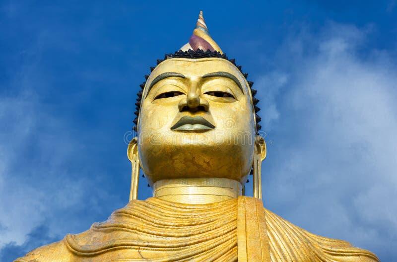 Buddha big statue close-up in the old temple of Wewurukannala Vihara, Dickwella, Sri Lanka. A 50m-high seated Buddha monument is the largest in Sri Lanka stock photos