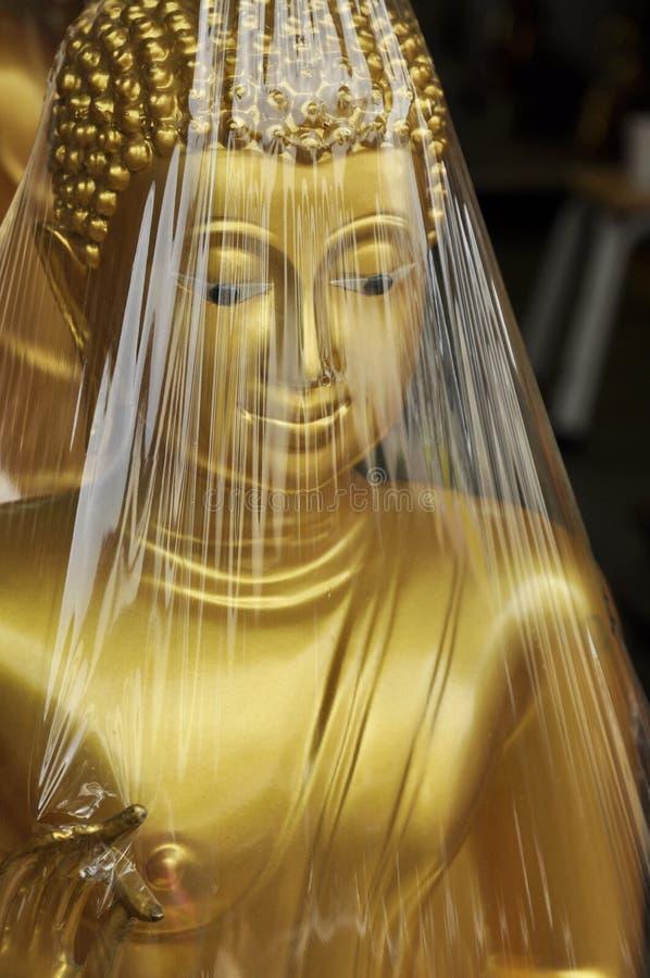 Buddha Body Face Wrap. Statue of reclining Gold Buddha Symbol of Buddhism royalty free stock photo