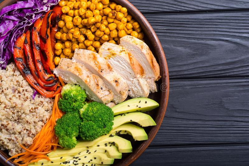 Buddha bowl with avocado chicken , pepper , quinoa and chickpea . Healthy food. Buddha bowl with avocado , chicken , pepper , quinoa and chickpea . Healthy food royalty free stock photography