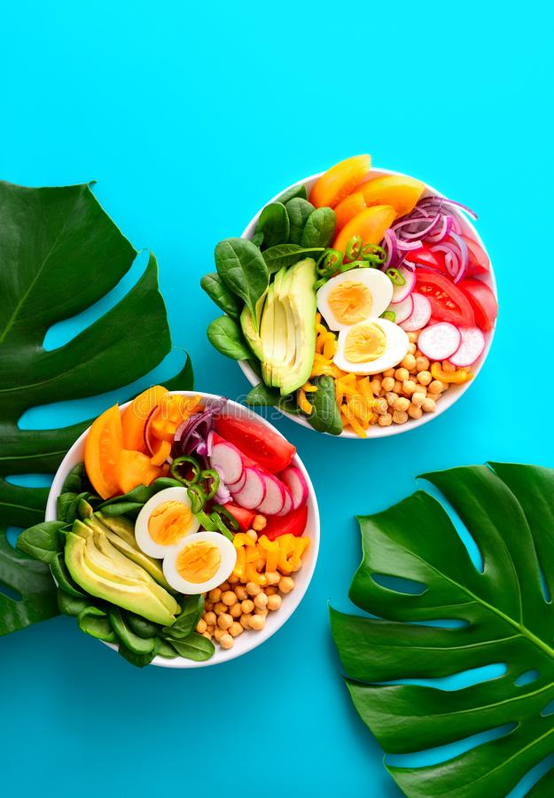 Buddha bowl with boiled eggs served on monstera leaves royalty free stock photo