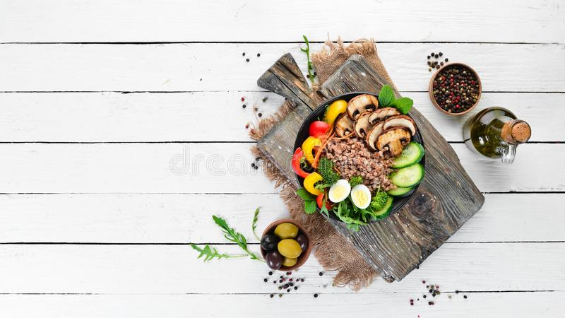 Buddha bowl. Buckwheat with mushrooms, eggs and vegetables. Top view. free space for your text royalty free stock images