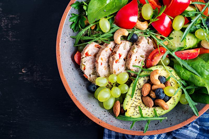 Buddha bowl dish with meatloaf, avocado, sweet pepper, tomato, cucumber, berries and nuts. Ketogenic diet. Buddha bowl dish with meatloaf, avocado, sweet pepper royalty free stock image