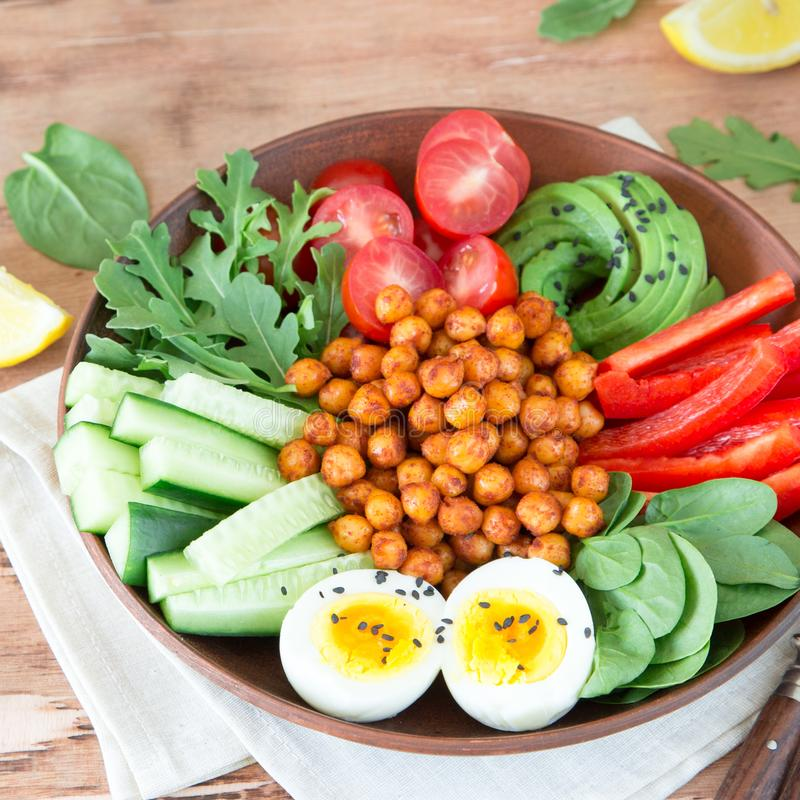 Buddha bowl, healthy and balanced food. Fried chickpeas, cherry royalty free stock photos