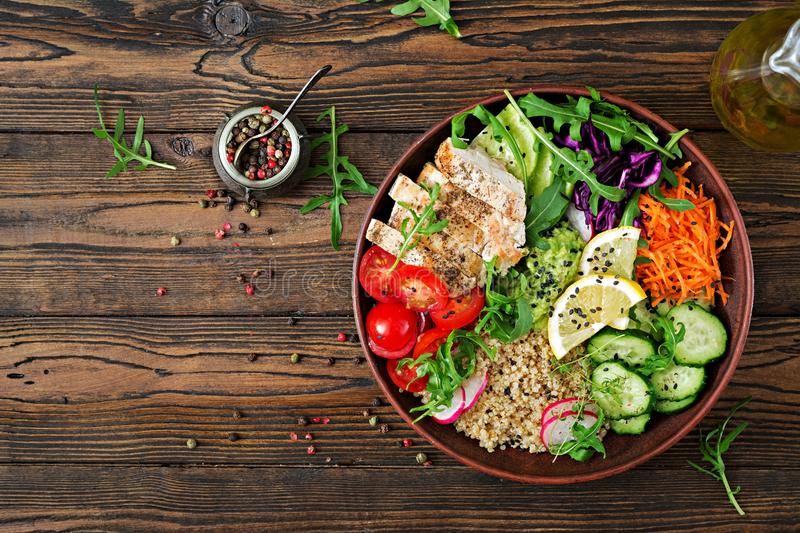 Buddha bowl lunch with grilled chicken and quinoa, tomato, guacamole. Healthy dinner. Buddha bowl lunch with grilled chicken and quinoa, tomato, guacamole stock photos