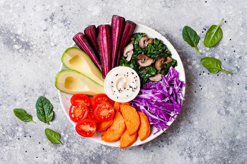 Buddha bowl with roasted butternut, hummus, cabbage. Healthy vegetarian appetizer or snack platter. Winter veggies detox lunch royalty free stock photo