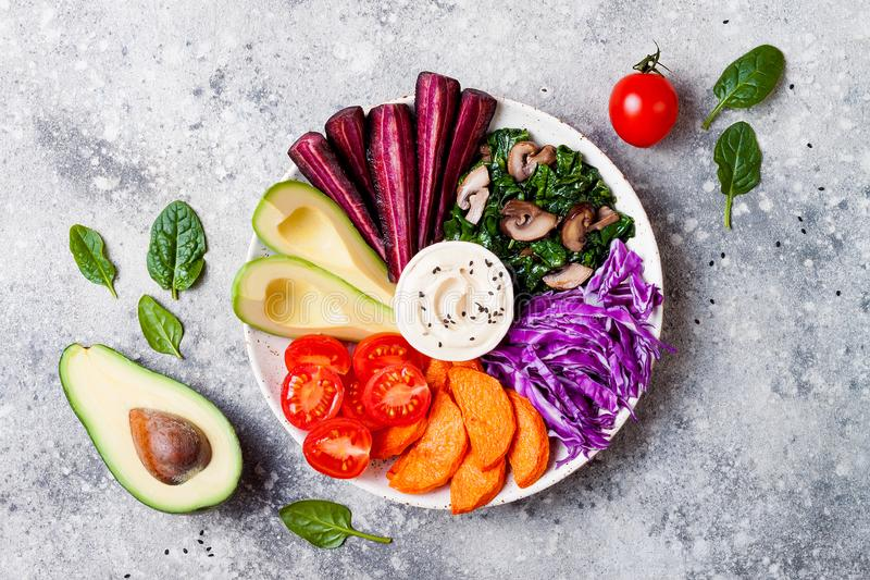 Buddha bowl with roasted butternut, hummus, cabbage. Healthy vegetarian appetizer or snack platter. Winter veggies detox lunch. Buddha bowl with roasted royalty free stock photo
