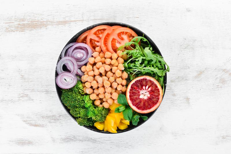 Buddha bowl. Turkish peas, broccoli, tomatoes, onions. Top view. Free space for your text stock photos