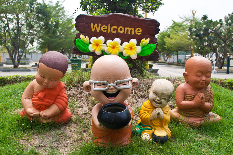 Buddha clay doll welcome stock photos