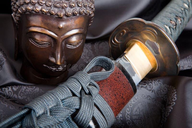 Buddha contra a espada imagens de stock
