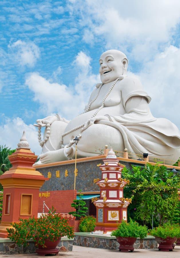 Buddha de risa de la pagoda de Vinh Trang, Vietnam foto de archivo libre de regalías
