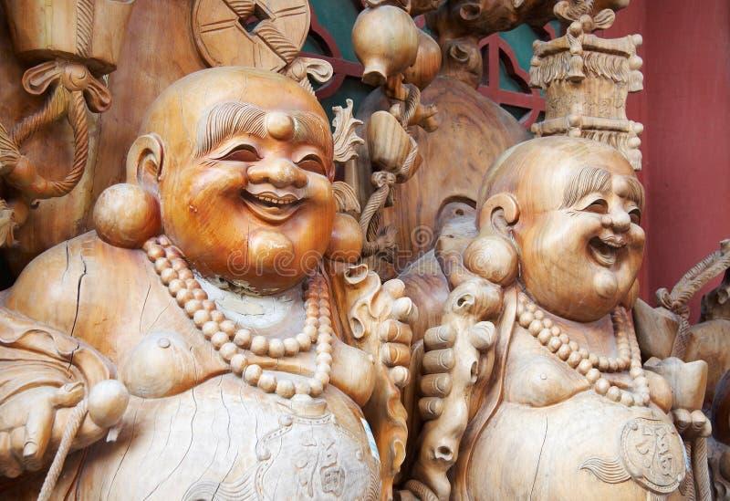 Buddha de sorriso de madeira fotografia de stock