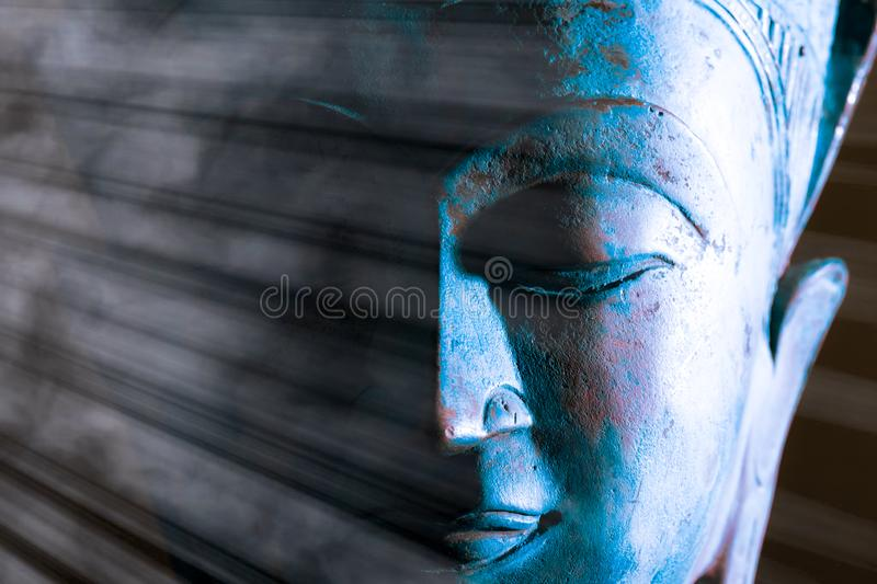 Buddha face close-up. Spiritual enlightenment. Zen Buddhism. Traditional Thai statue stock images