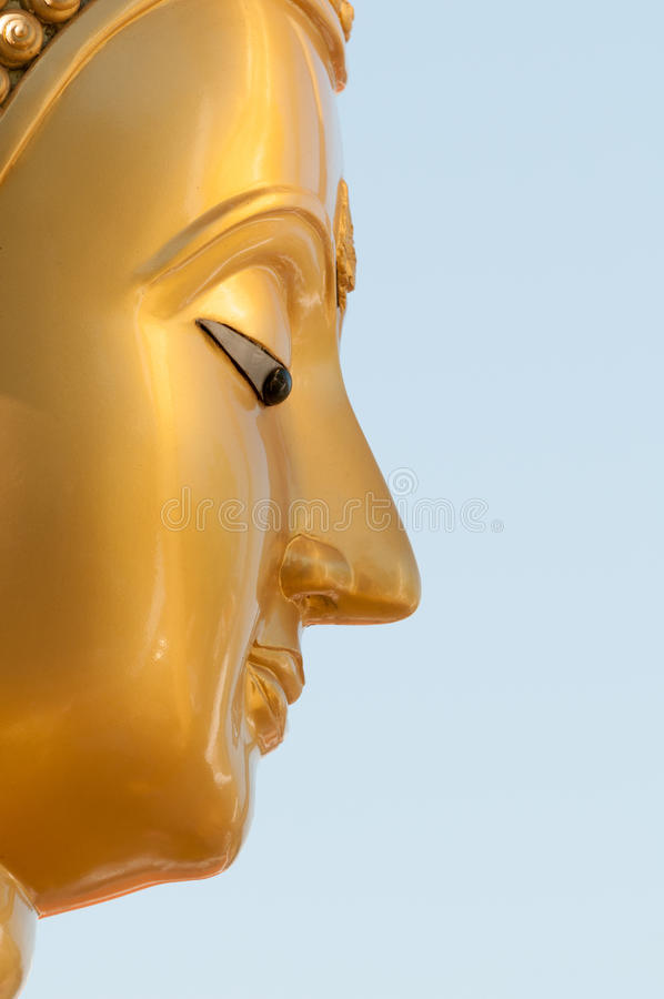 Buddha face in profile royalty free stock images