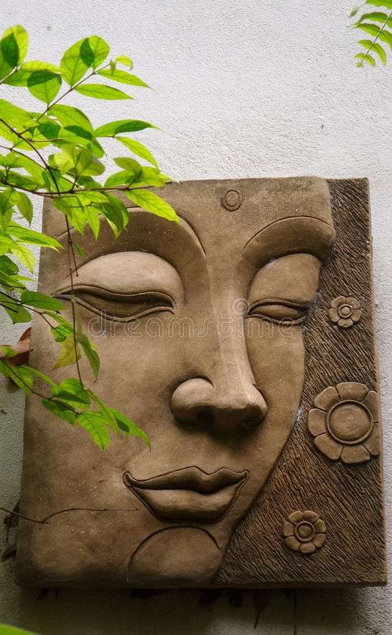 Download Buddha Face Sculpture On White Wall Stock Image   Image Of Face,  Garden: