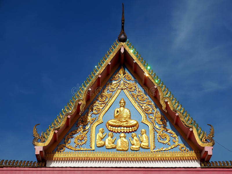 Buddha and the first five monks. Skilfully crafted gable at Buddhist temple featuring Buddha and the first five monks stock photography