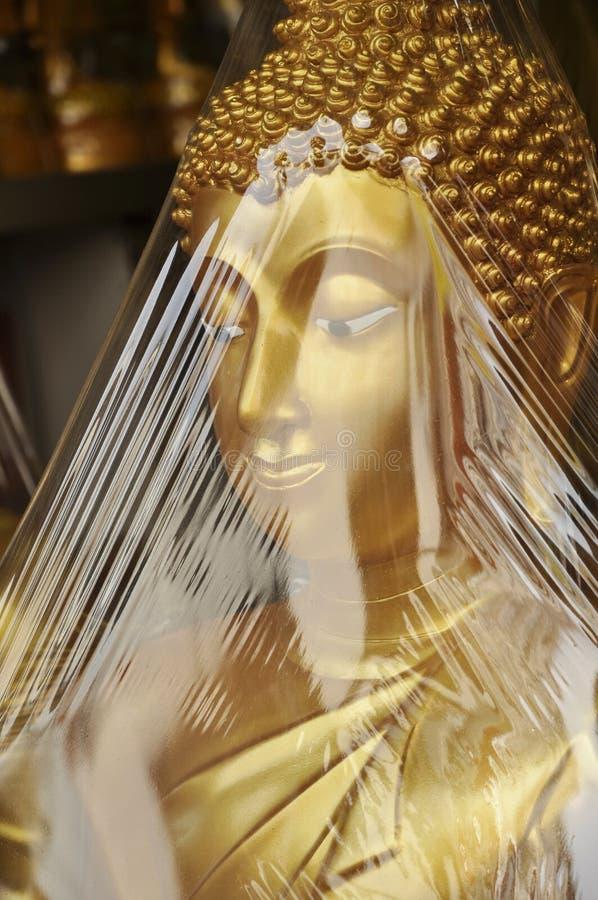Buddha Head Face Wrap. Statue of reclining Gold Buddha Symbol of Buddhism stock images
