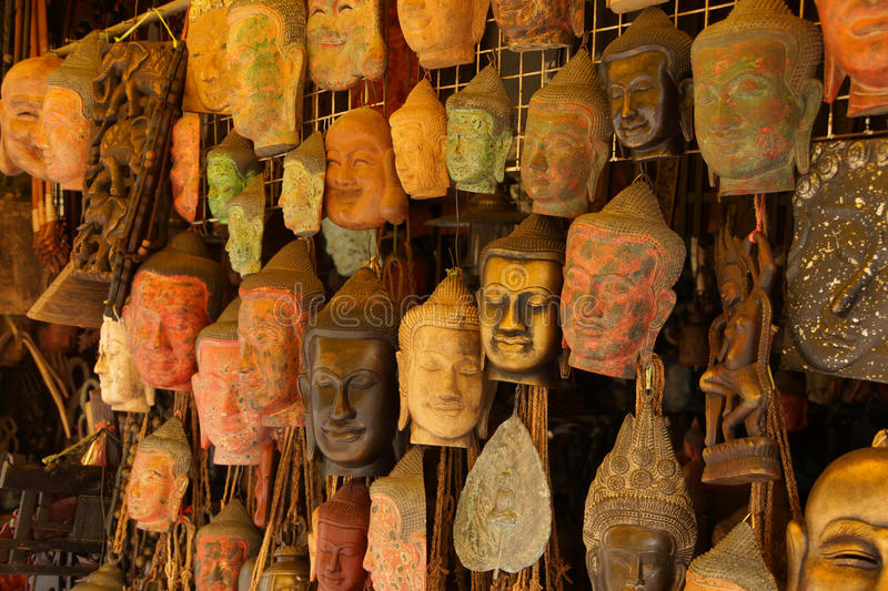 Buddha head masks and carvings stock image