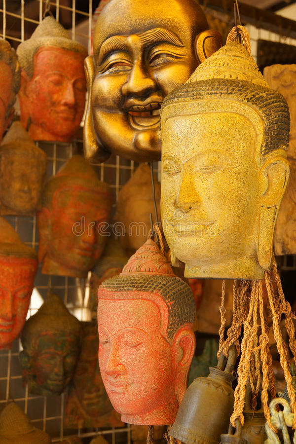 Buddha head masks and carvings royalty free stock images