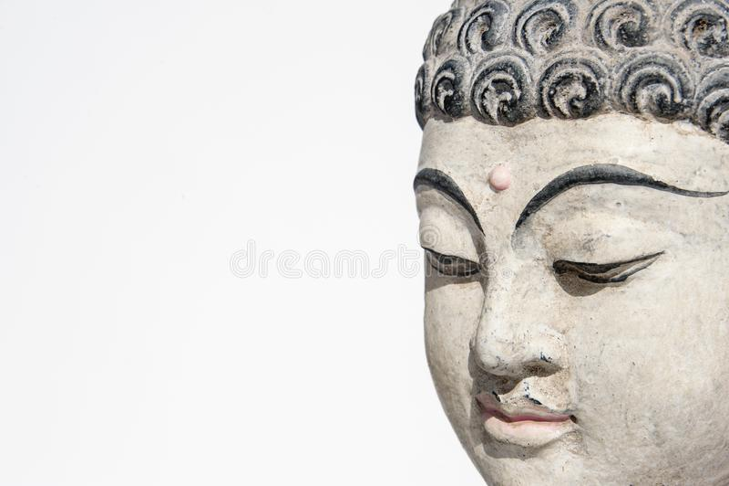 Buddha Head Meditating On A White Background stock images