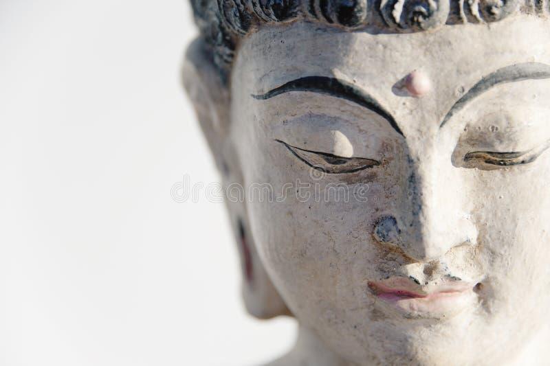 Buddha Head Meditating On A White Background royalty free stock images