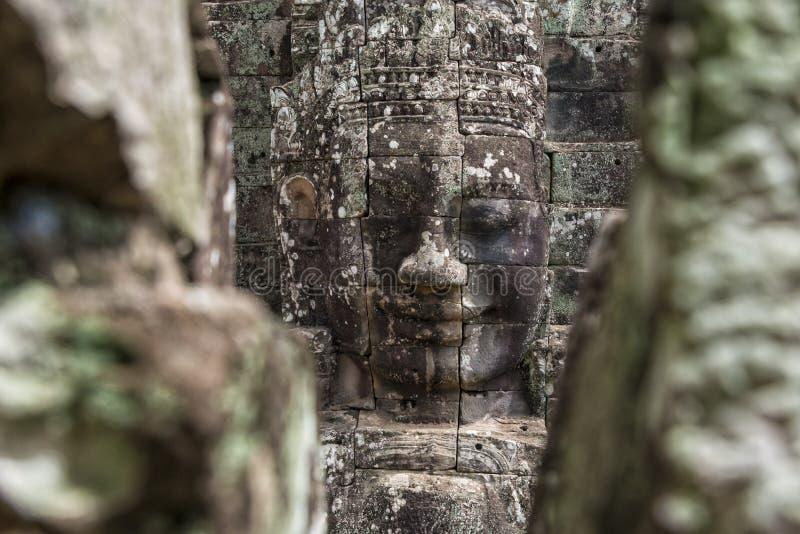 Buddha heads på den Bayon templet, Angkor Wat, Cambodja royaltyfria bilder