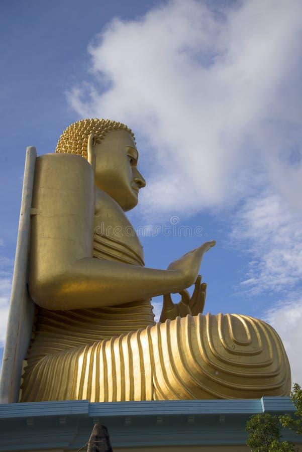 Buddha i den guld- templet Dambulla Sri Lanka royaltyfria bilder