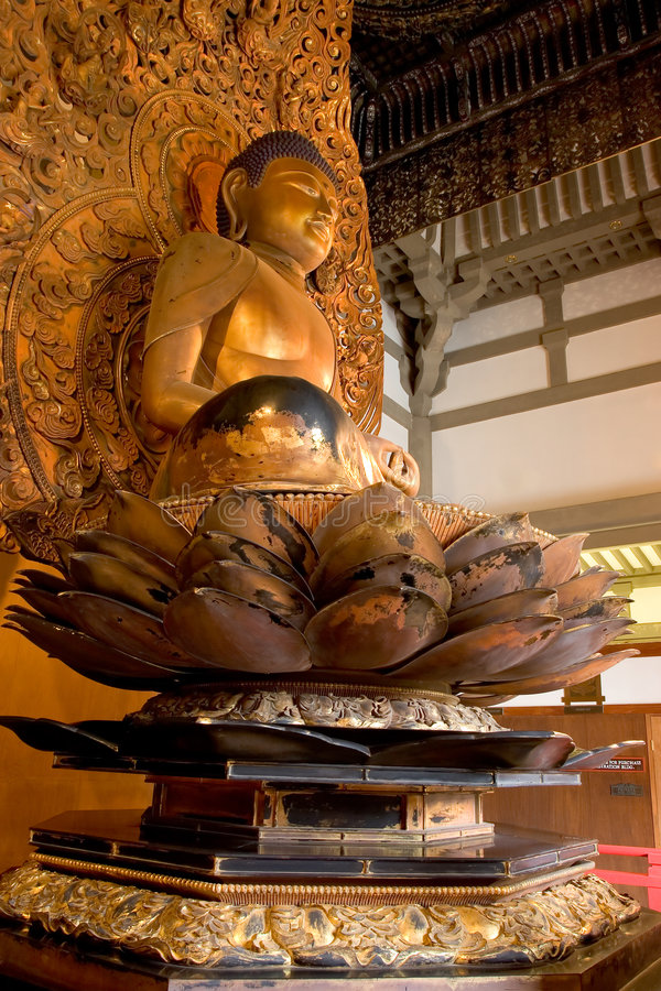 Buddha Idol. At the Byodo-In temple in Oahu, Hawaii royalty free stock photography
