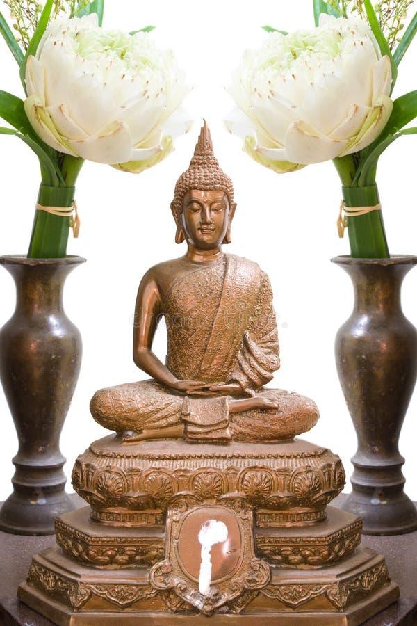 Buddha image. Offer sacrifice lotus flower to buddha image royalty free stock images