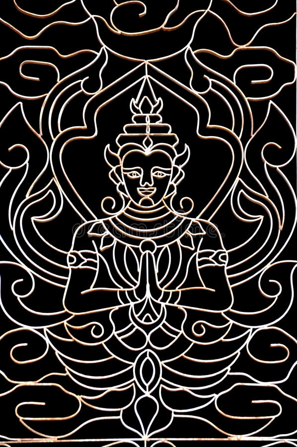 Buddha image. At the window in Wat Ong Teu Mahawihan (Temple of the Heavy Buddha), Vientiane, Laos stock photo