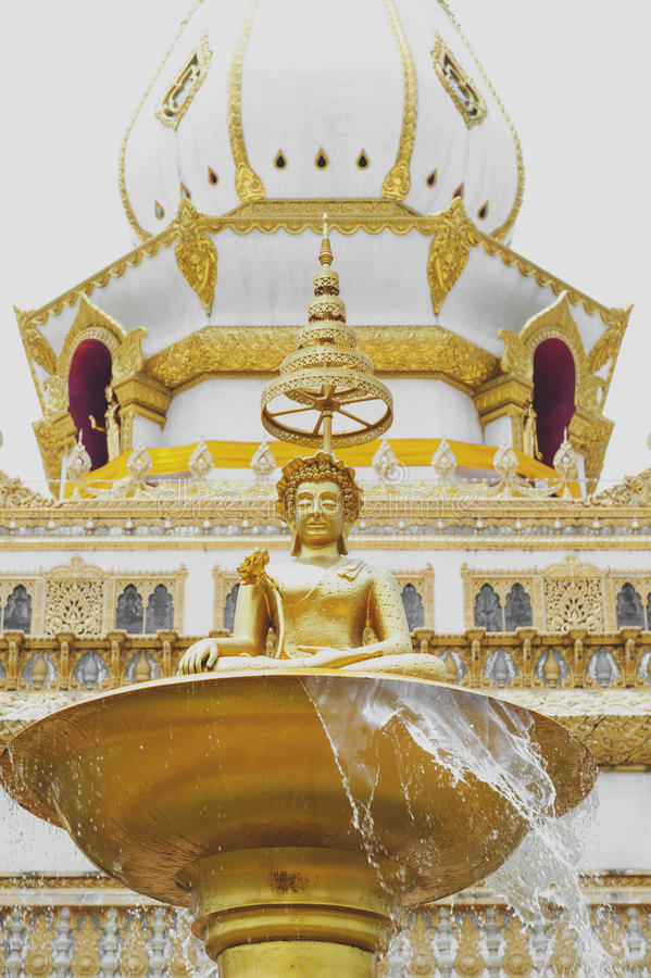 Buddha image on decorating fountain in in front of Phra Maha Chedi Chai Mongkol, Roi Et province, northeastern Thailand. Buddha image on decorating fountain in stock photography