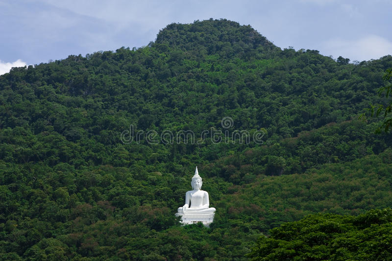 Buddha image on mountain stock image