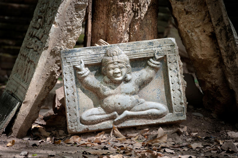 Buddha image on a part of a broken stone relief at Wat Umong, Chiang Mai, Thailand royalty free stock photos