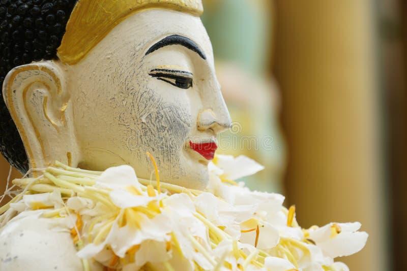 Buddha image statue at Shwedagon Pagoda temple, Myanmar stock images