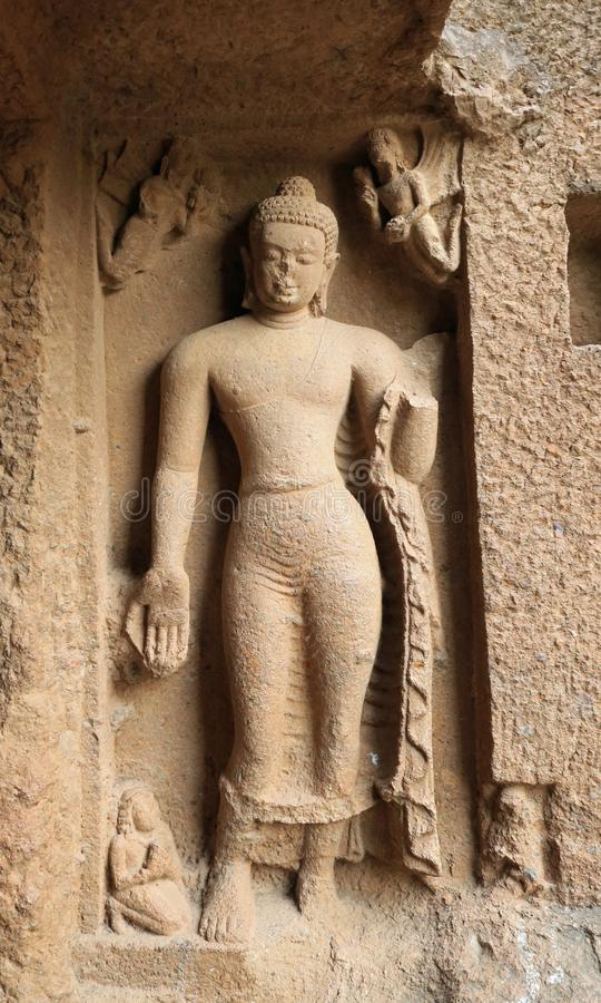 Buddha - Kanheri Caves. An early sculpture of Buddha at Cave 1 of Kanheri Caves - his palm facing outwards royalty free stock photos