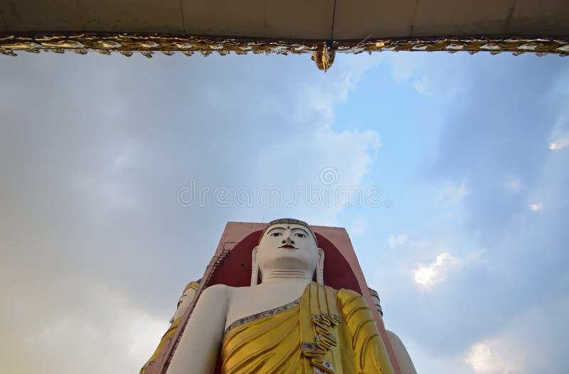 Buddha of Kyaik Pun Pagoda Bago, late evening blue sky and temple roof royalty free stock photos