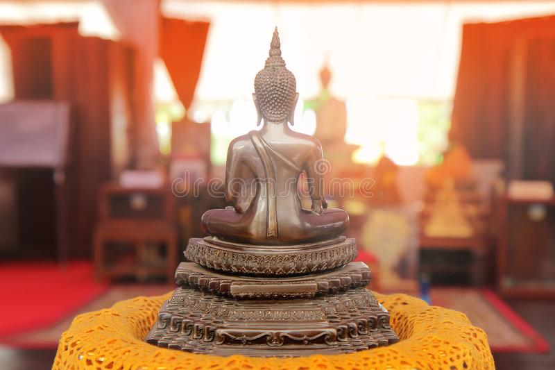 Buddha meditating on a lotus base 5 step. Photographed from beh stock photography