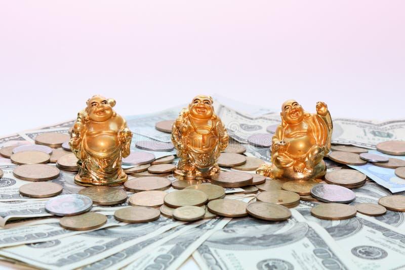 Buddha netsuke and money stock photo