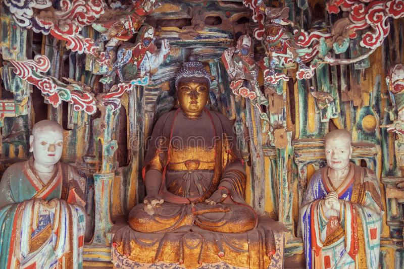 Buddha and other statues in the Hanging Temple. Editorial: DATONG, SHANXI, CHINA, April 8, 2019 - Buddha and other statues in the Hanging Temple near Datong royalty free stock photography