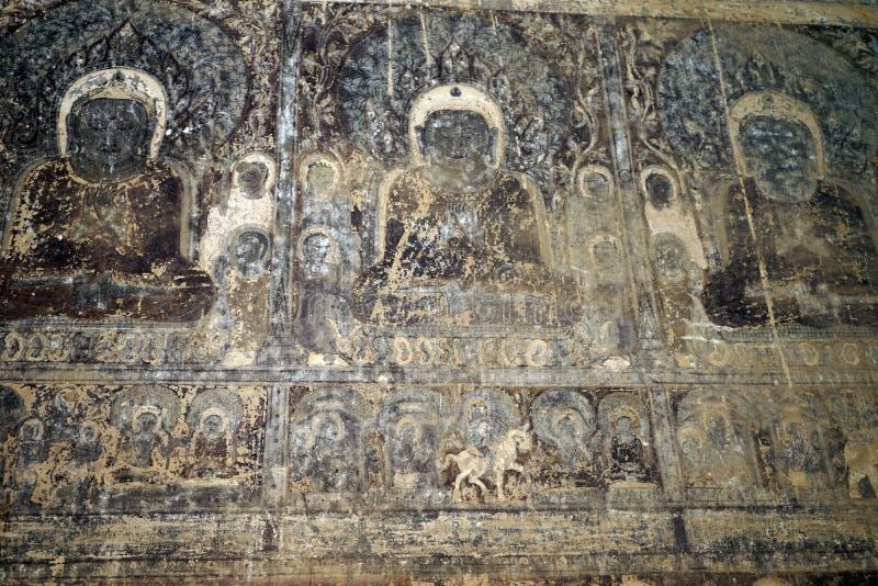 Buddha på väggen royaltyfria bilder