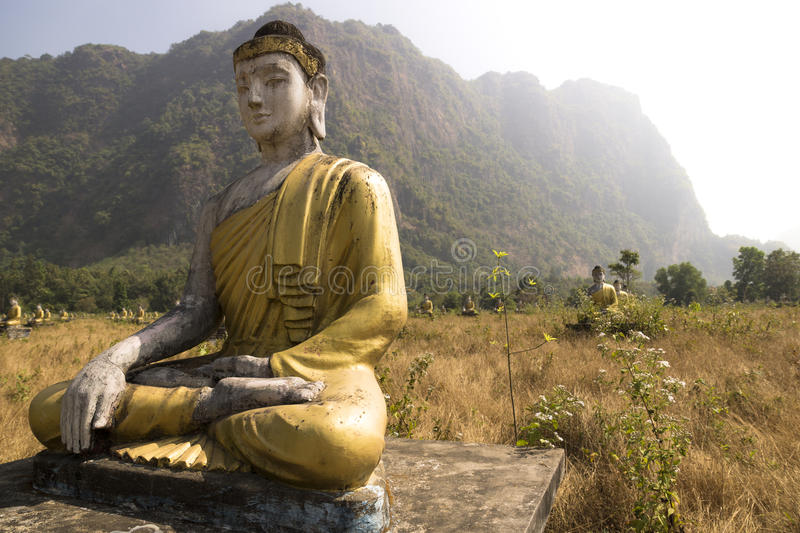 Buddha park. With 1000 buddha statues in front of karst mountains near Hpan, Myanmar royalty free stock photography