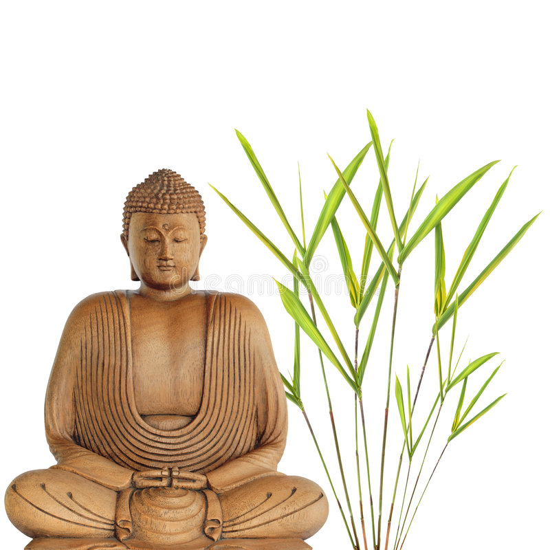 Buddha Peace. Buddha in meditation with bamboo leaf grass, over white background royalty free stock photography