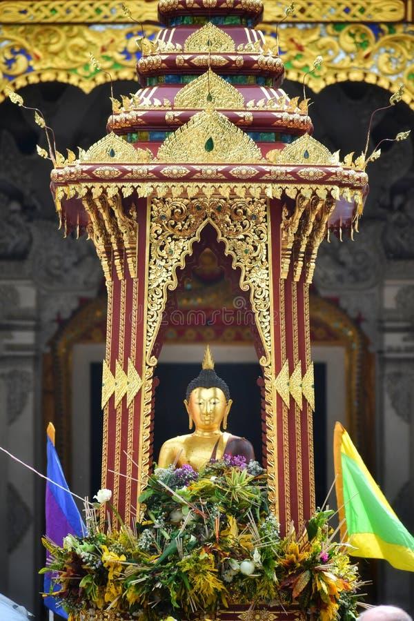 `Pra Chao Fon San Ha` from Chang Tam temple in Inthakin city pillar festival Sai Khan Dok. Buddha of rain or Thai say `Pra Chao Fon San Ha` from Chang Tam stock photo