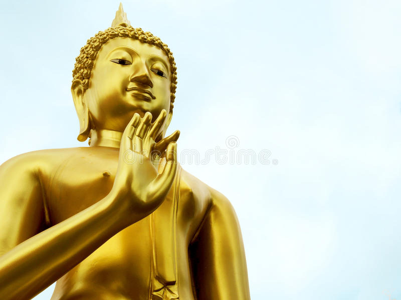Buddha`s blessing. Gold Buddha statue in blessing with copy space stock photography