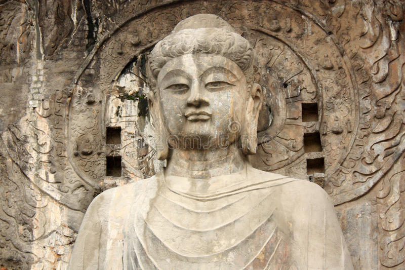 Buddha's statue in Longmen Grottoes, China. Buddha's statue in Longmen Grottoes at Yi River, Luoyang City, Henan province, China stock photo