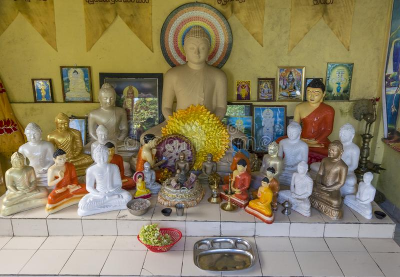 Buddha`s statues at the buddhist altar stock photography