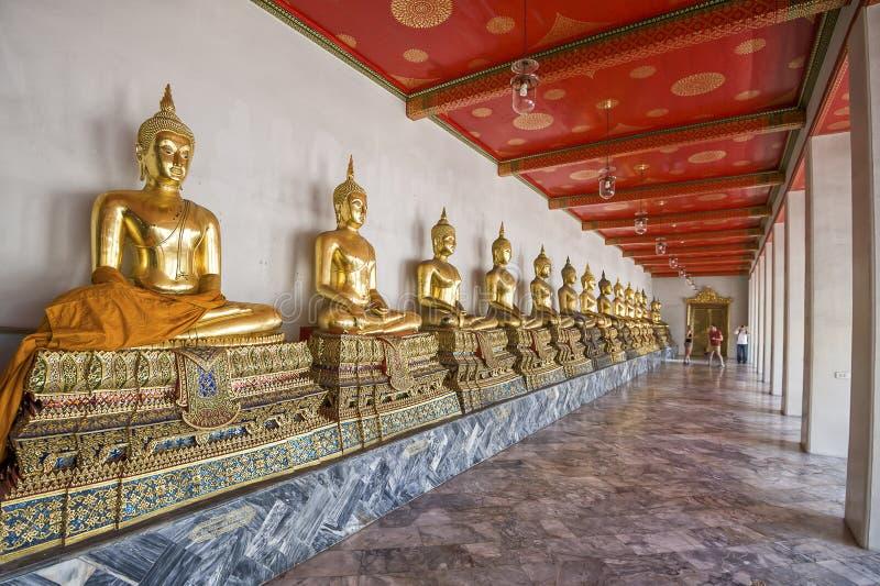 Buddha's in Wat Pho Temple, Bangkok, Thailand. Golden buddha's in the Wat Pho temple in Bangkok, Thailand royalty free stock photo