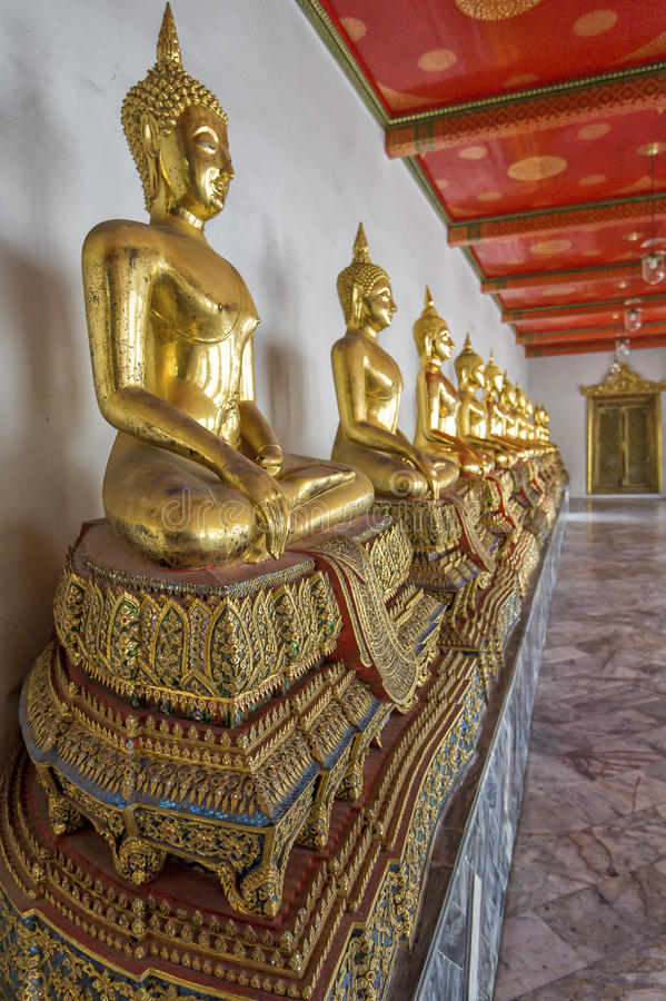 Buddha's in Wat Pho Temple, Bangkok, Thailand. Golden buddha's in the Wat Pho temple in Bangkok, Thailand royalty free stock images