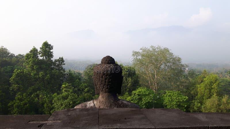 Buddha& x27; s zurück lizenzfreie stockfotografie