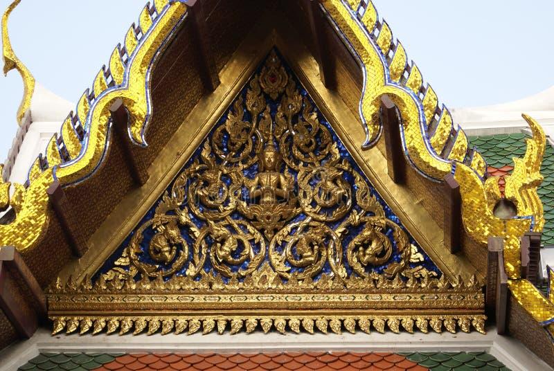 Buddha sculpture. The front gable of Wat Phra Kaew, The Grand Palace, Bangkok, Thailand, Asia. Details of the front gable of Wat Phra Kaew, The Grand Palace royalty free stock photography